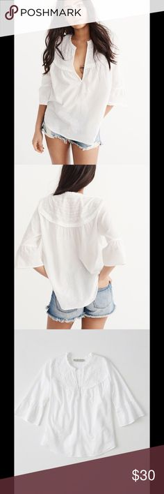 A&F NEW WITH TAGS EMBROIDERED BLOUSE NEW WITH TAGS!! NEW FOR SPRING SEASON!!! RETAILS FOR $58.00. A great white  blouse with v-neckline and bell sleeves, A clean look and easy to wear style. Pair with jeans, leggings, shorts, skirts, or put it over your bathing suit as a cover up for the beach to get there stay there or leave there. Has embroidery detail throughout, soft fabrication. 100% Cotton Embroidery:100% Polyester Machine wash cold, with like colors Only non-chlorine bleach…