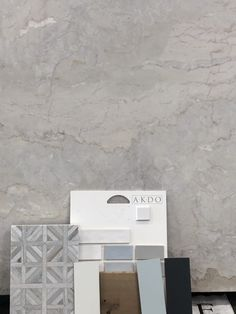 Material is a natural quartzite stone. The white, beige and grey stone is called Dolce Vita. It took two slabs to cover all that. Here it is laid out with the backsplash mosaic, AKDO tile and floor and paint possibilities. Slabs and tile were bought at All Natural Stone, San Jose.