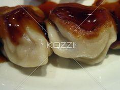 Chinese chicken dumplings drizzled in teriyaki sauce