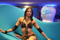 Mylan's stand for 'The Imaginarium of Dr. Mylan' conference. Belly dancer reclining.