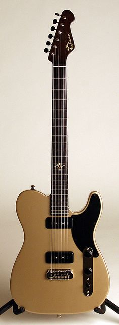 Thorn So Cal G/T #102 2013 Shoreline Gold | • Body:Solid Korina with tummy cut • Neck: Dark Roasted Maple (Hand-rubbed Tru-oil finish) • Fretboard: African Blackwood  • Bridge: Thorn Hardtail w/ rear loaded Stopbar • Pickups: Thorn GT-90 – 1 of 5