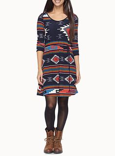A dress that slips on easily and can be worn either dressed up or dressed down   Tribal-inspired multicolour geo patterns   Fine stretch knit, soft to the touch   Fine stretch knit lining   Tie cord belt included    The model is wearing size small
