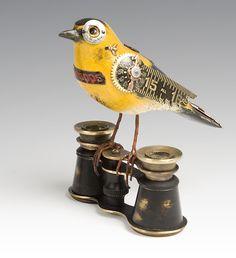 """Goldfinch on Binoculars"" Wood Sculpture by James Mullan."