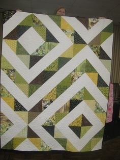 I made this quilt using the Prismatic pattern from the Little Bits Quilting Bee book. It was pretty easy and used a layer cake.