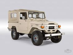 View details of this 1977 Beige FJ43. Highlights include Full nut and bolt restoration, Matching-numbers engine and chassis and 5-speed transmission. Want an FJ Land Cruiser? Call The FJ Company today!