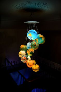 "Beautiful ""chandelier"" made of 15 world globes. I've searched everywhere even for single glowing globe! Desk Globe, Globe Lamps, Globe Chandelier, Globe Lights, Chandelier Lighting, Light Globes, Chandeliers, Globe Art, Globes Terrestres"