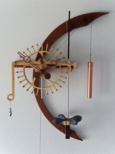 """Radiance"" is a one-wheel, no gear clock that impulses its free torsion pendulum once every two minutes. Wooden Gear Clock Plans by Clayton Boyer Clock Designs Wooden Clock Plans, Wooden Gear Clock, Wooden Gears, Wood Clocks, Wall Clock Plans, Wall Clock Design, Diy Clock, Into The Woods, Rustic Walls"
