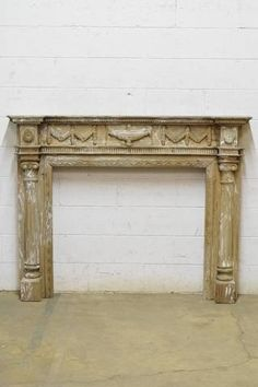 An antique Tudor Gothic style limestone mantel fireplace surround ...