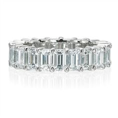 R5173, Shared prong, emerald cut diamond eternity band. 6.43ct. total.