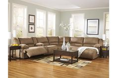 Tan leather sectional recliner couch, chaise lounge, and coffee table View 1