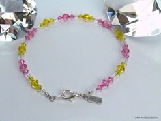 """Show your ankle some sparkle!  This 9.5"""" Pink/Yellow/White Swarovski Crystal Anklet Would Do Just That.  Sterling Silver Lobster Claw Clasp.  Bicone Beads Vary In Size From 4mm-6mm  Handcrafted and One-Of-A-Kind From The RICCI Designs Anklet Collection.  Only $39.99 With FREE Shipping!  Please visit us at WWW.RICCIDESIGNS.COM for more gemstone and Swarovski Crystal jewelry creations."""