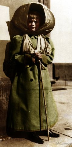 Anastasia in her traveling coat and hat.