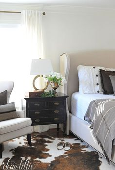 These gold circle lamps from HomeGoods add a nice modern touch to this masculine cozy brown and cream bedroom. (sponsored pin)