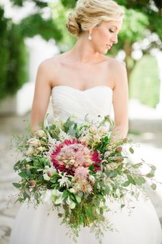 Stunning lush protea bouquet | Amy Campbell http://southernweddings.com/2016/06/23/alys-beach-wedding-amy-campbell/