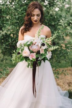 Strapless bridal style & a bouquet of white, pink, and purple | The Twins Photography