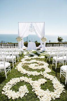 A Classic Draped Chuppah | 23 Wedding Chuppah Ideas We Love | https://www.theknot.com/content/creative-wedding-chuppah-ideas