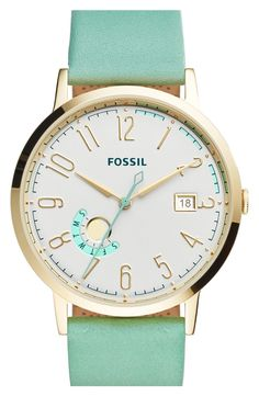 Currently crushing on this darling Fossil watch with a mint green leather strap and gold details.