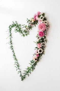 Heart-shaped Greenery + Floral Backdrop Piece from a We Love Lucy Pink + Gold Baby Shower via Kara's Party Ideas | KarasPartyIdeas.com