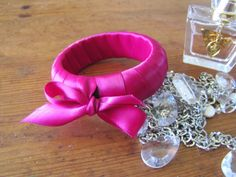 DIY ribbon wrapped bangle from Confetti Workshop. Easy way to jazz-up an old bangle.
