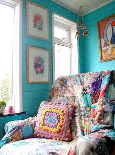 lovely blue walls, bright throw over the chair and crochet pillow