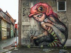 """Aber natürlich gibt es in """"Streetart in Germany"""" auch klassische Graffitis zu bestaunen: In Lüneburg hat Herakut dieses Bild auf eine Wand gezaubert."""