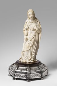 Virgin Mary, 18th century.  Artist/maker unknown, Hispano-Philippine.  Ivory, mounted on a wood base, covered with repoussé and chased silver, 14 15/16 x 6 1/4 x 5 inches (37.9 x 15.9 x 12.7 cm).  Base: 4 3/4 x 13 inches (12.1 x 33 cm).  Roberta and Richard Huber Collection.