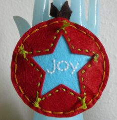 embroidered felt Christmas ornament - good idea to cut-out the shape instead of putting it on top