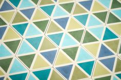 Tile pattern Triangle, available in blue/green, red/yellow and greyscale.  Cement tiles in moroccan style. For flooring or wall mounting in ktichen and bathrooms, or actually any room. Even outdoors!