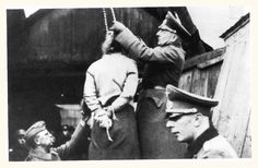 A female Soviet partisan being prepped with her noose after being captured during a partisan raid.    It was routine for the Germans to interrogate then execute all captured partisans in the East. In some cases entire villages were wiped off the map for being accused of harboring partisans, or for simply being in the area after a partisan assault.
