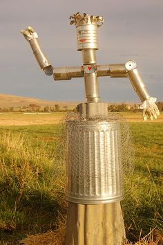 *A whimsie for the yard... Tin Can Scarecrow