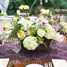 Vintage Fall:  Ivory, soft-yellow and lavender garden roses, greens and hydrangeas were one of the many tablescape designs.