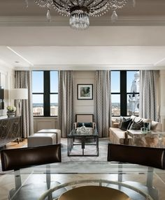 The warm and inviting living space in The Ritz-Carlton Suite has a spectacular view of Philadelphia City Hall's iconic clock tower.