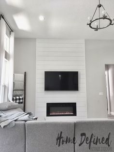 Defining your living room with a farmhouse DIY shiplap accent wall does not have to be costly or difficult. Learn how to make your own faux shiplap from plywood and create an easy and affordable Fireplace Accent Walls, Fireplace Tv Wall, Fireplace Built Ins, Accent Walls In Living Room, Shiplap Fireplace, Bedroom Fireplace, Fireplace Remodel, Living Room With Fireplace, Home Living Room