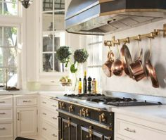 Black La Cornue Range + Hanging Copper Pot & Pan Storage + White Cabinets #Kitchen