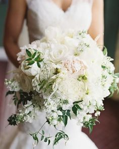 This soft pretty white and blush pink #peony #bouquet with #trailingvines by #AFloralAffair topped our list of #floralarrangements in 2015! Planning and design: @amandaspencer. Photo: @virgilbunao. #SnippetFavorites2015 by snippetandink