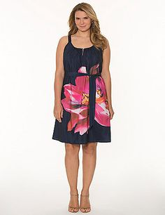 Sleek, silky dress is packed with personality, featuring a bold, placed floral print and buttoned keyhole neckline. #LaneBryant