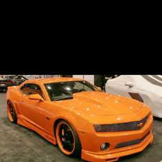 Ooh. Badass, but too much orange it looks like a blob, needs some other color for detail or something but car in general is awesome