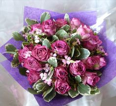 Handtied bouquet, with stems in water, of 15+ #pinkroses with filler greenery.