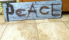 Peace sign made from recycled tools and a piece of barn wood I painted and destressed