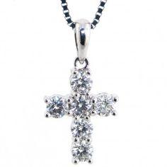 Bright and brilliant diamond cross pendant set in 18kt white gold.