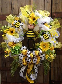 This decomesh wreath is sure to BEE an eye catcher! Perfect for everyday use or spring through summer! Measures 23 inches! All wreaths are coated
