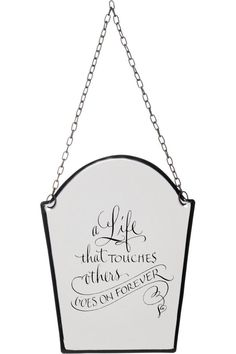 "This thoughtful and stylish enamel sign reads: ""A life that touches others goes on forever."" High quality enamel and curved edges with a black border make these signs just beautiful. Made by America Retold this sign hangs from the attached chain. This inspirational sign measures 6.5"" high by 5.5"" wide.  Lives Forever Sign by America Retold. Home & Gifts - Home Decor - Wall Art Boulder Colorado"