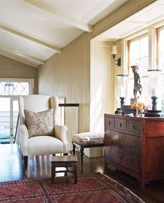 A sunny sitting area at the top of the stairs provides a quiet space for contemplation. - Traditional Home ®/ Photo: Joe Schmelzer / Design: Virgil W. McDowell