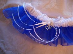 Royal Blue organza and White satin wedding garter - Style 3B. Silver double-heart charm and rhinestone add sparkle.