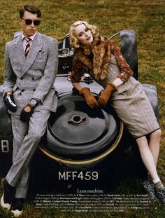 1930's fashion- the man in a suit and tie, and woman in knee high skirt and fur around kneck both looking very 1930's