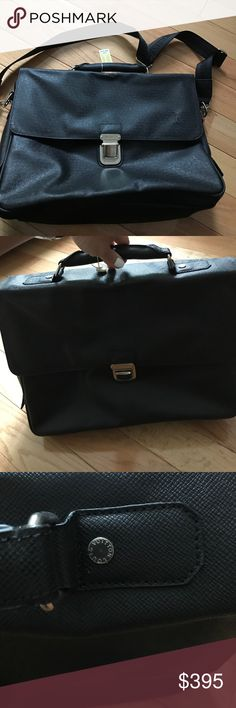 LV Taiga black leather briefcase messenger bag Brand new LV black Taiga leather briefcase messenger bag with engraved adjustable nylon strap zippered pocket and large compartment with interior zippered pocket and pen holder and 2 small pockets. Top handle and push in silver lock Louis Vuitton Bags Laptop Bags