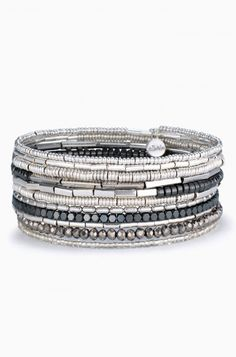 The Celine Wrap Bracelet in Silver contains semi-precious hematite, metallic and shiny silver beads. Shop coil wrap bracelets at Stella & Dot.