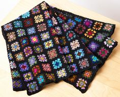 Miniature granny squares. Each two-inch square is made with cotton embroidery floss.