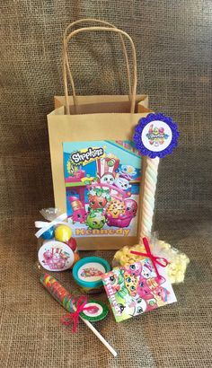 Shopkins Birthday Party Favors and Bags - Personalized Goodie Bag Bundle - PlayDoh Popcorn Lollipop Marshmallow Twist Bubble Gum - Set of 10 - MyPartyElements