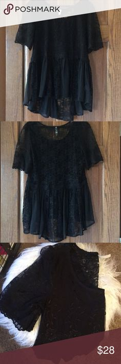 🌻 FREE PEOPLE lace black lace peplum top! 🌻 Free people  Show a little skin by wearing it with a bralette  Or wear a tank top under it to dress it up!  Sheer black lace  Peplum body style  No flaws  Size small but fits loosely, could fit a medium!  So beautiful I just don't wear it enough Free People Tops Blouses